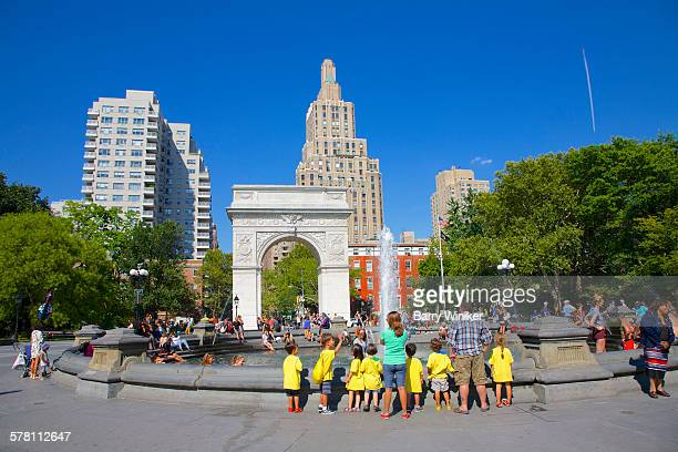 kids in vests in washington square park, nyc - washington square park stock pictures, royalty-free photos & images