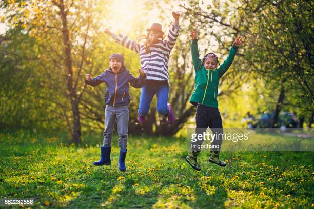 Kids jumping with Spring joy