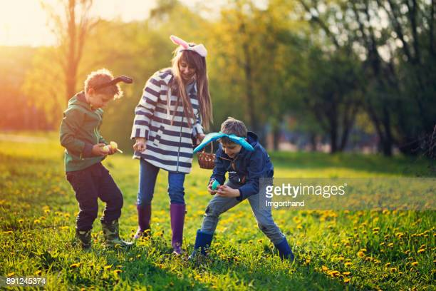 kids jumping with spring joy - easter stock pictures, royalty-free photos & images