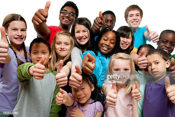 kids k through 12th grade giving thumbs up - school children stock pictures, royalty-free photos & images