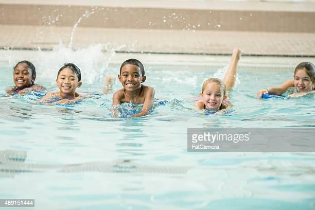Kids Kicking in the Water