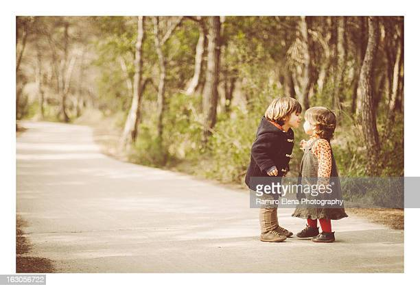 Kids kissing in the woods