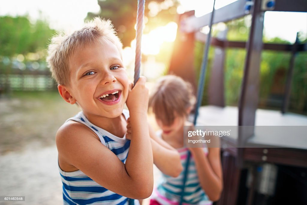 Kids laughing at the playground : Stock Photo