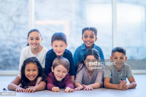 Kids Laying On The Floor