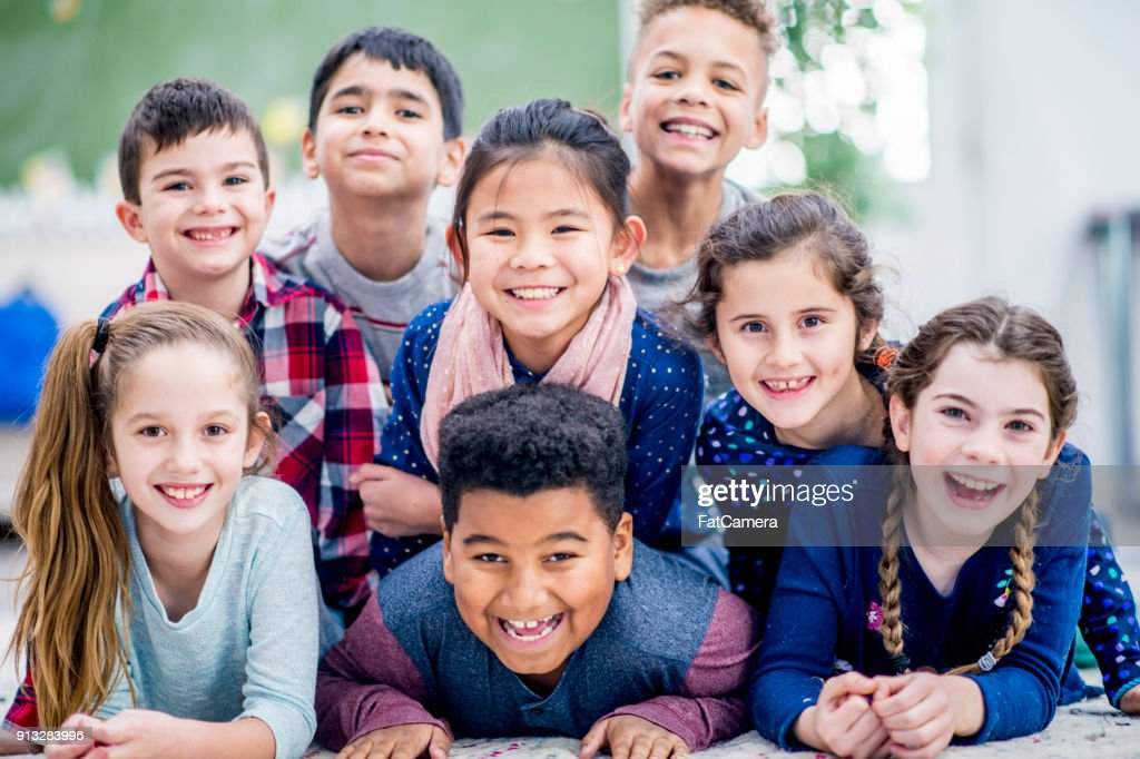 Kids Laying On The Floor : Stock Photo