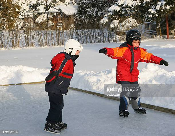 kids learning ice skating in a small skating ring - ice rink stock pictures, royalty-free photos & images