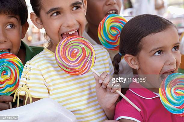 Kids Licking Giant Lollipops