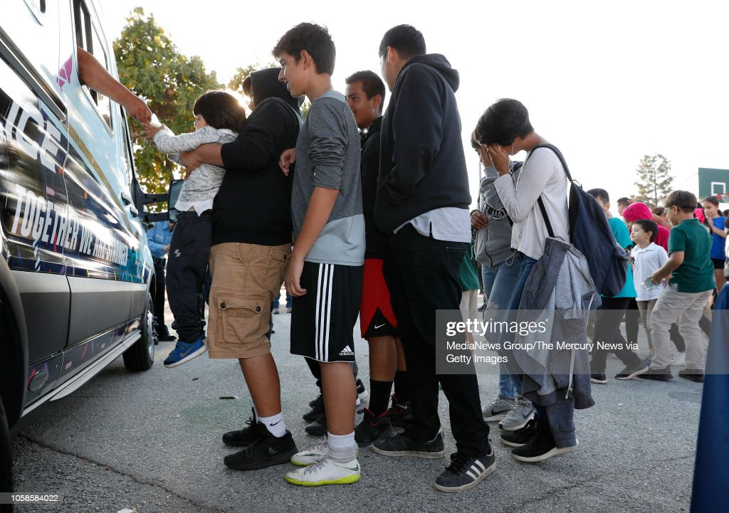 Kids line up to get ice cream from the San Jose Police Department's