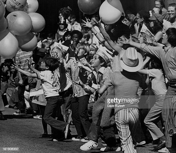 MAR 11 1972 MAR 12 1972 Kids Lined The Route Of The St Patrick's Day Parade In Downtown Denver Saturday They vied for free balloons and candy thrown...
