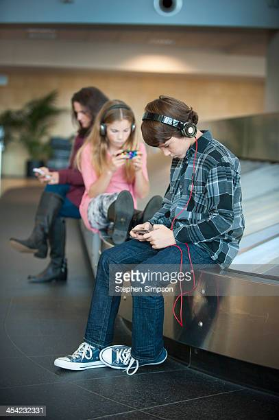 kids listening to music at airport
