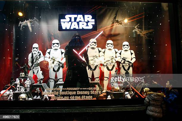 Kids look at characters from the Star Wars movie 'Star Wars Episode VII The Force Awakens' during the Christmas illuminations at the Galeries...