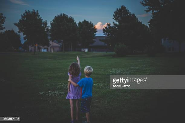 Kids looking at storm clouds