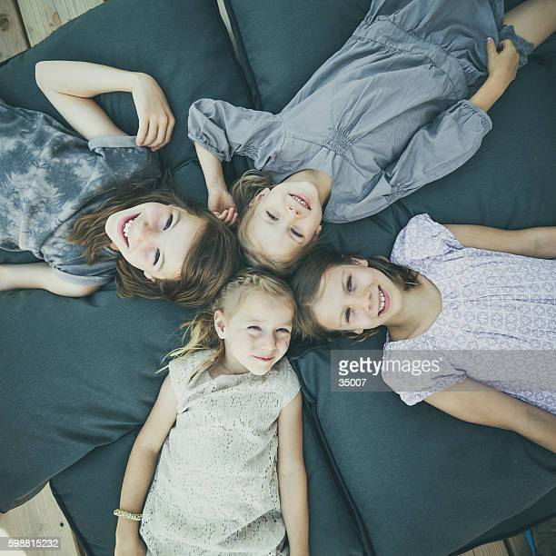 kids lying on pillows - petite teen girl stock photos and pictures