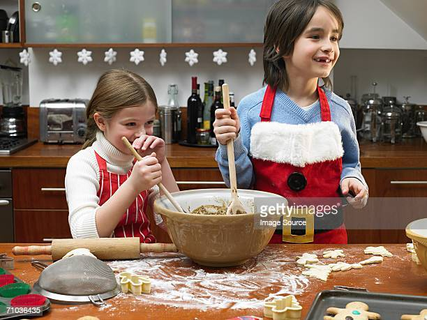 kids making cookies - naughty santa stock photos and pictures
