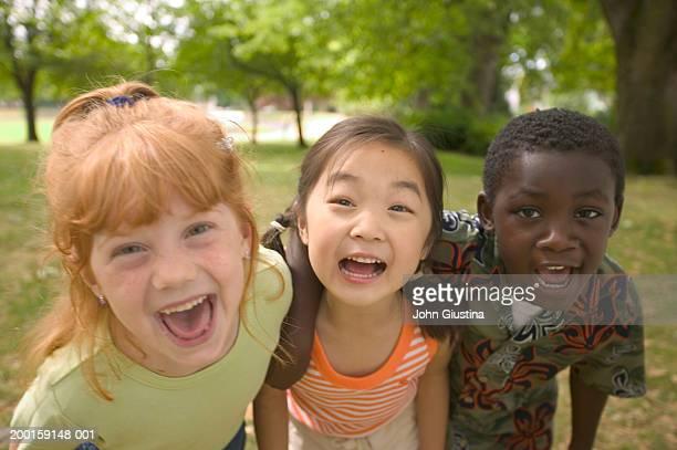 Kids (6-8) making faces, smiling, portrait