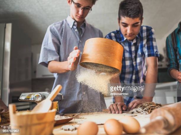 Kids Making pasta  in the kitchen