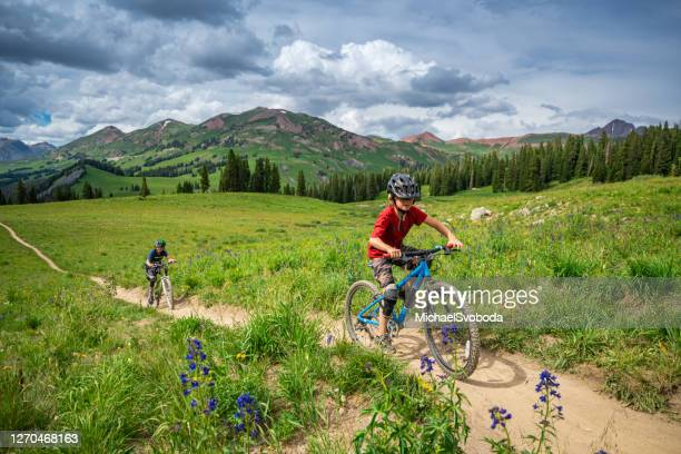 kids mountain biking in amazing beauty - colorado stock pictures, royalty-free photos & images
