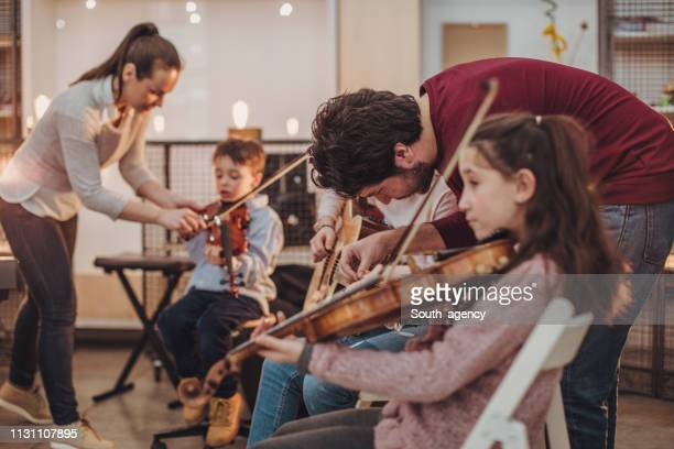 kids music school class - orchestra stock pictures, royalty-free photos & images