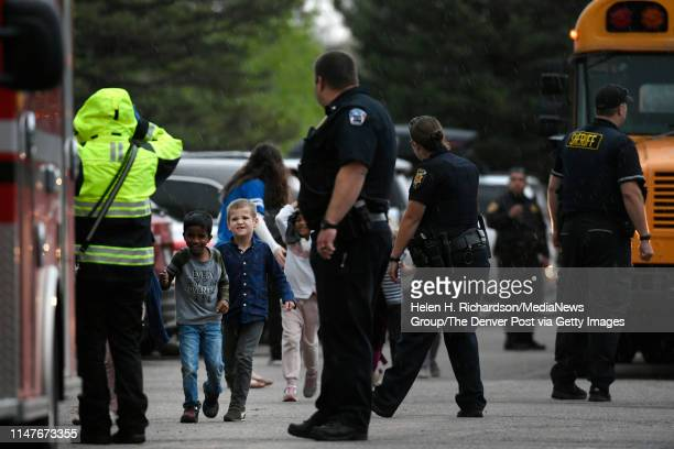 Kids of all ages are brought off buses to be reunited with their parents at the Highlands Ranch Recreation Center at Northridge after a shooting at...