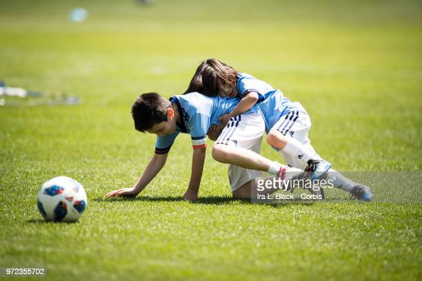 Kids of David Villa of New York City play on the pitch prior to the MLS match between New York City FC and Atlanta United FC at Yankee Stadium on...