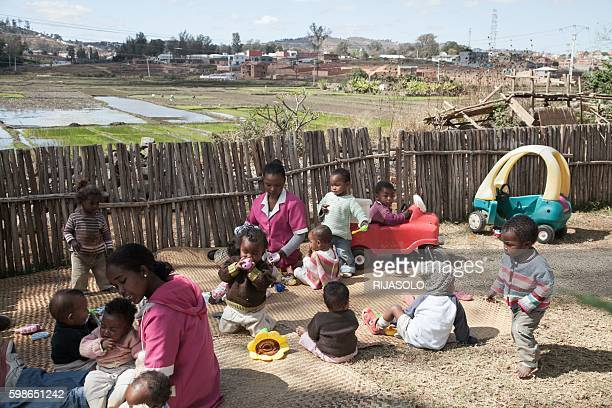 "Kids of young single mothers, are taken care by the NGO ""Aina - Enfance et Avenir"" in Antananarivo on July 29, 2016. In Madagascar, where more than a..."