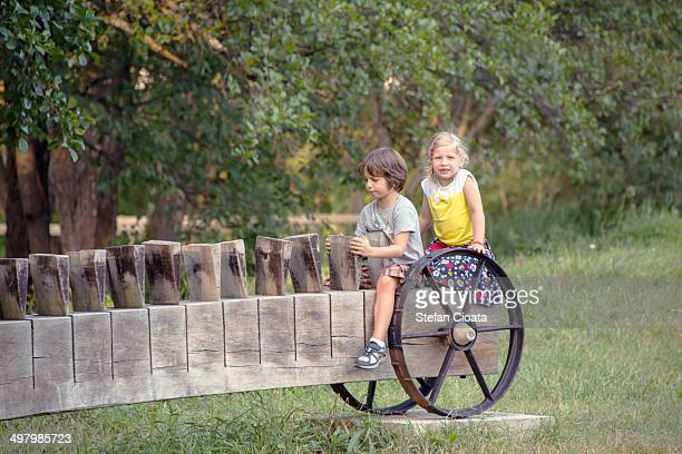 Kids on a Rustic old cart