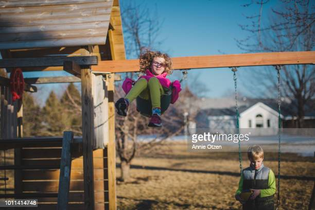 Kids on backyard swing set