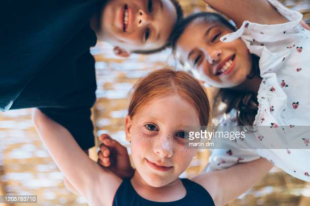 kids on beach holiday - martin dm stock pictures, royalty-free photos & images