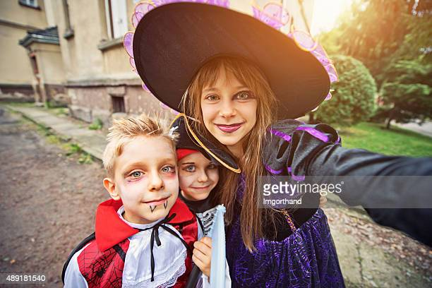 Kids on halloween taking selfie