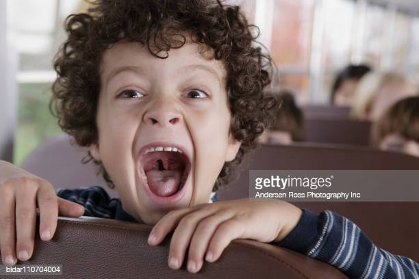 kids on school bus - uvula stock photos and pictures