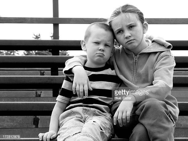 kids on the bleachers - broer stockfoto's en -beelden