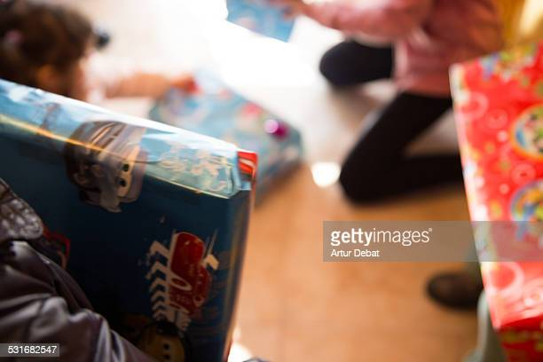 Kids opening his presents on the morning of the Three Kings Day for the January 6th in Barcelona Catalonia Europe