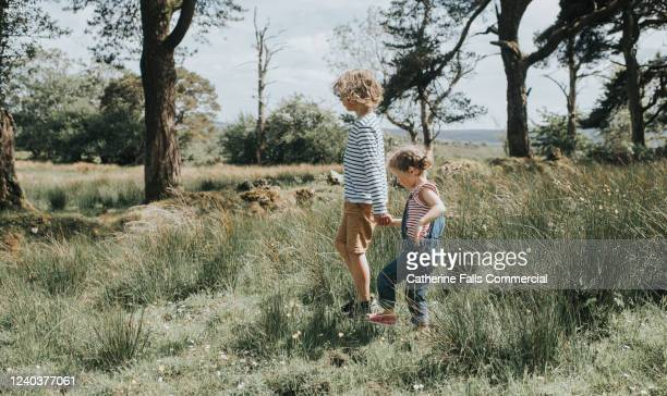 kids outside - natural parkland stock pictures, royalty-free photos & images