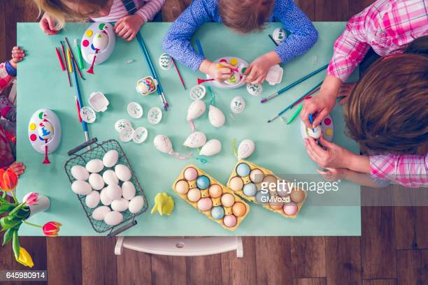 kids painting easter eggs - happy easter mom stock pictures, royalty-free photos & images
