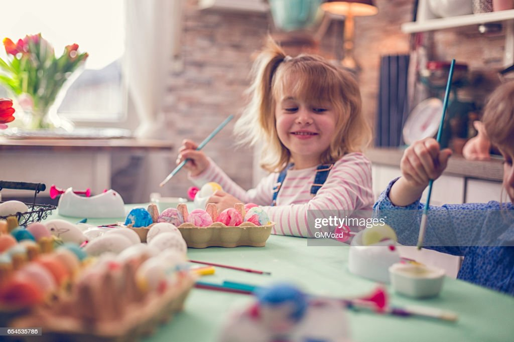 Kids Painting Easter Eggs : Stock Photo