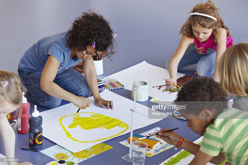 Kids painting in schoolclass : Stock Photo