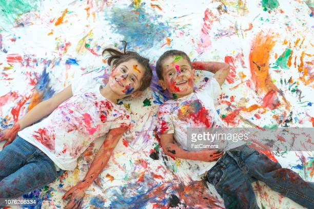 kids painting - kids art stock pictures, royalty-free photos & images