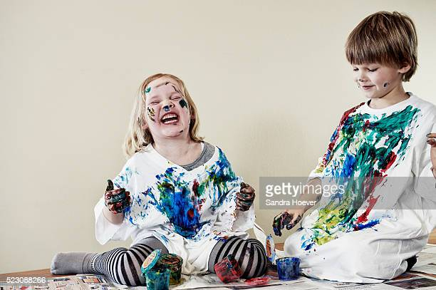 Kids painting themselves