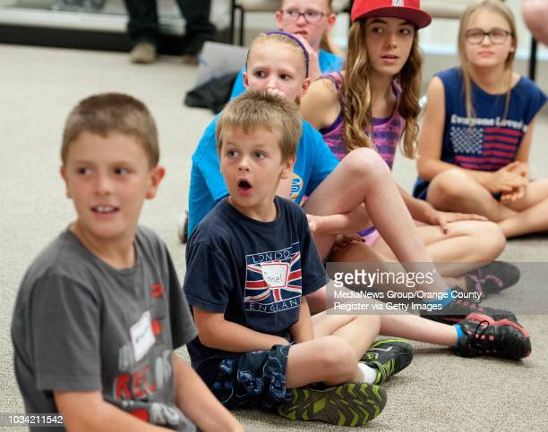 Kids participating in Lake Forest's safety academy class react as Dave Mondrine of Get Safe enters the room in a black fullbody protective suit The...