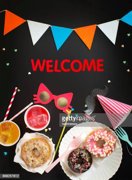 Kid's party food and drink with 'Welcome' sign.