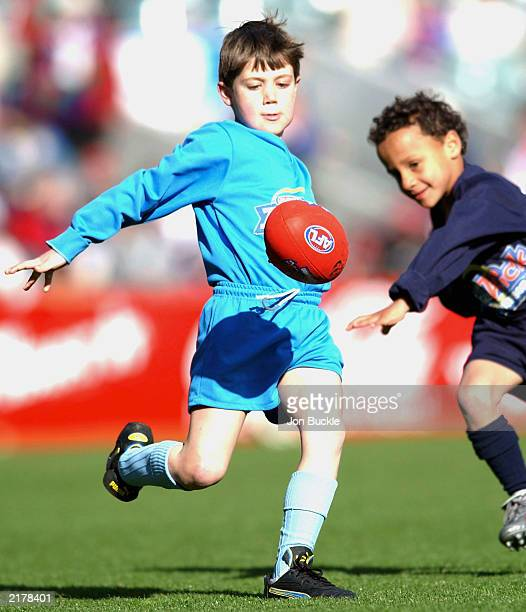Kids paticipate in Auskick at halftime during the AFL round 16 game July 20 2003 between the Fremantle Dockers and Adelaide Crows at Subiaco Oval in...