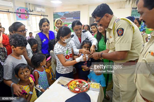Kids patients suffering from diseases like cancer thalassemia and kidney celebrate Raksha Bandhan with police officials at Bai Jerbai Wadia hospital...