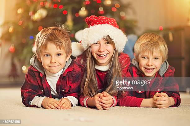 Kids photo near the christmas tree