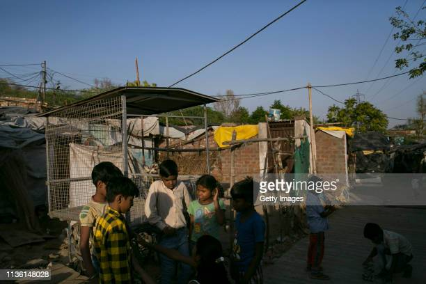 Kids play a game in a slum on April 9, 2019 in Bhopal, India. With a rising number of jobless youths, unemployment and poverty have been at the top...