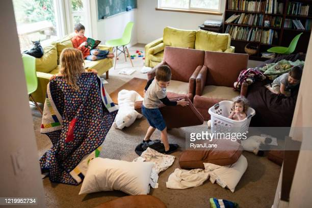 kids play and imagine in messy living room - messy stock pictures, royalty-free photos & images