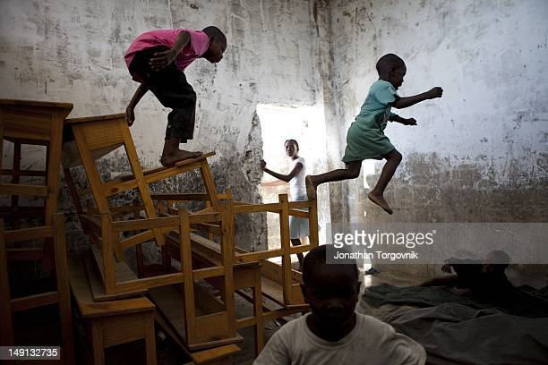 Kids play at a building that was used as a prison when Duvalier was president. It is now used as a makeshift school, and a playground for kids...