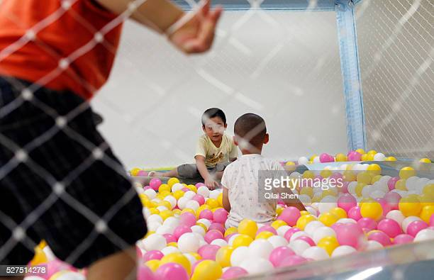 Kids play at an indoor playground in Shanghai China on 26 July 2011 The director of the Population and Family Planning Commission of Guangdong...