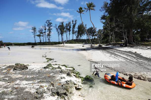 Kids play at Eton Beach on November 30 2019 in Efate Vanuatu Satellite data show sea level has risen about 6mm per year around Vanuatu since 1993 a...