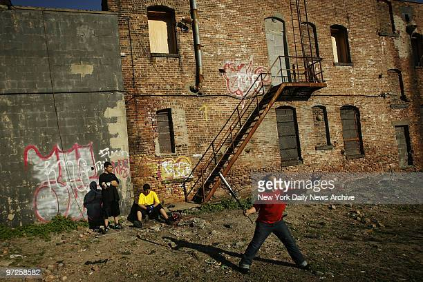 Kids play baseball in an abandoned lot off of Third Avenue in the South Bronx where major rezoning has been approved which stands to severely change...