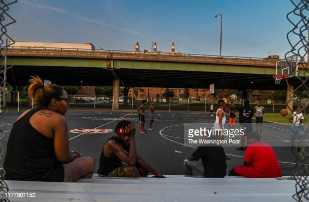 Kids play basketball at Wilson Park near where highway I81 slices through the public housing complex called Pioneer Homes in the south side of the...